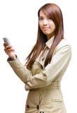 azjatykci telefon komórkowy używać kobiety potomstwo Fotografia Royalty Free