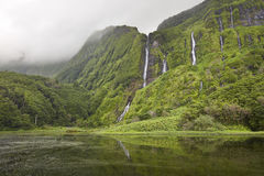 Azores landscape in Flores island. Waterfalls in Pozo da Alagoin Stock Photography