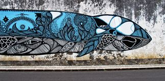 A large whale fish painted on a concrete wall stock photo