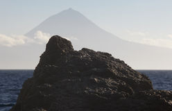 Azores volcanic rock with Pico mountain and atlantic ocean. Royalty Free Stock Image