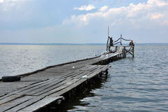 Azov Sea, old wooden pier. The Azov Sea, the old wooden pier, a seagull Stock Image