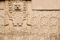 Aztec background. Showing ancient god and some inscriptions Royalty Free Stock Photo