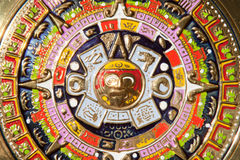 Aztec Calendar. Golden plate full of colors. Aztec Calendar with Tonatiuh from the central disk royalty free stock photography