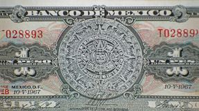 Aztec Calendar Sun Stone. Piedra del Sol and Mayan bas-relief on Mexico 1 peso 1967 banknote, Mexican money Stock Photos