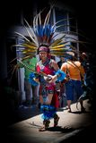 Aztec Dancer at the Artesian Arts Festival. Aztec Dancer. SULPHUR, OKLAHOMA-May 26, 2018: An Aztec dancer strolls the sidewalk at the Artesian Arts Festival Stock Photography