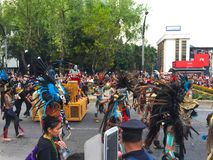 Aztec dancers in day of the death parade Royalty Free Stock Image
