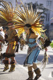 Aztec dancers. Dressed in traditional costumes participate in the Grand Marian Procession through downtown Los Angeles Stock Photography