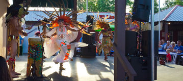 Aztec Dancers. A performance of the Ballet Folklórico Nacional of Milwaukee, Wisconsin, demonstrating traditional Aztec Dance, with colorful costumes and ornate Royalty Free Stock Image
