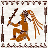 Aztec of South America sitting with truncheon in brown colors Royalty Free Stock Images