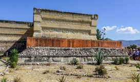 Aztecs ruins visitors at Mitla. First occupied by Mistec and Zapotec civilization during 14th century before Aztecs arriving in 1494, Mitla ruins are well royalty free stock photography