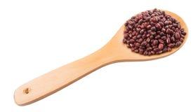 Azuki Bean On Wooden Spoon III. Adzuki or Azuki bean on wooden spoon over white background stock photos