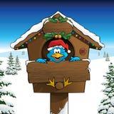 Azulão-americano que comemora o Natal em uma paisagem do inverno Fotografia de Stock Royalty Free