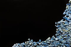 Azul boquira granite, crushed granite blue on a black background. Azul boquira granite, crushed granite blue on a black royalty free stock photos