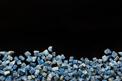 Azul boquira granite, crushed granite blue on a black background. Azul boquira granite, crushed granite blue on a black stock images