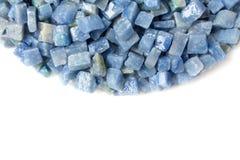 Azul boquira granite, crushed granite blue on a white background. Azul boquira granite, crushed granite blue on a white royalty free stock image