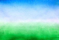 Azul-c?u e fundo verde foto de stock