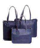 Azul de lujo de tres de las mujeres bolsos del ` s aislado en blanco Imagen de archivo