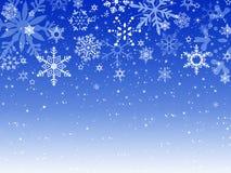 Azul del fondo de la Feliz Año Nuevo de la Feliz Navidad, nieve Fotografía de archivo libre de regalías