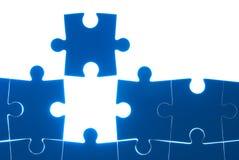 Azul del rompecabezas aislado en el fondo blanco Imagenes de archivo