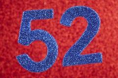 Azul do número cinquenta e dois sobre um fundo vermelho anniversary Foto de Stock Royalty Free