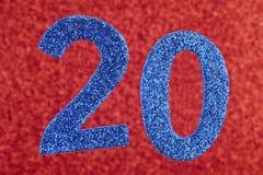 Azul do número vinte sobre um fundo vermelho anniversary horizonta Imagem de Stock Royalty Free