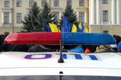 Azul e sirenes de piscamento vermelhas do carro de polícia, Ucrânia Fotografia de Stock Royalty Free