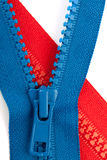 Azul e vermelho zippers o close up Fotografia de Stock Royalty Free