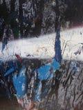 Azul oxidado con la indirecta del rojo en negro imágenes de archivo libres de regalías