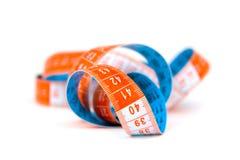 Azul y cinta de medición anaranjada Imágenes de archivo libres de regalías