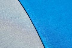 Azul y Grey Fabric Seam Swatch Costura de la camiseta azul imagen de archivo libre de regalías