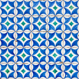 Azulejo with blue circles and white petals ornamen. The photo shows the Azulejo with blue circles and white petals ornament Stock Photos