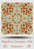 Azulejo ceramic tile in beige, olive green and red terracotta. Vintage ceramic faience. Traditional spanish pottery. Product with multicolored symmetric Royalty Free Stock Photos