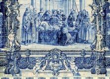 Azulejos on Capela das Almas in Porto, Portugal. Azulejo depicting the perishing of Francis of Assisi Stock Images