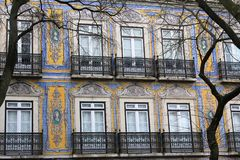 Colourful azulejos on the buildings in Lisbon, Portugal. Azulejo is a form of Spanish and Portuguese painted tin-glazed ceramic tilework. Azulejos are found on Stock Image