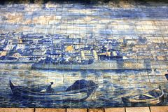 Blue azulejos on the buildings in Lisbon, Portugal. Azulejo is a form of Spanish and Portuguese painted tin-glazed ceramic tilework. Azulejos are found on the Royalty Free Stock Photos