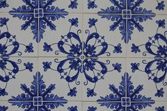 Blue azulejos on the buildings in Lisbon, Portugal. Azulejo is a form of Spanish and Portuguese painted tin-glazed ceramic tilework. Azulejos are found on the Royalty Free Stock Photography