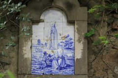 Blue azulejos on the buildings in Lisbon, Portugal. Azulejo is a form of Spanish and Portuguese painted tin-glazed ceramic tilework. Azulejos are found on the Stock Photo