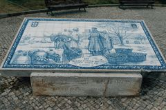 Azulejo tile plate with historic snene on public square in Faro city. Faro is capital of the district of the same name, in the Alg. Arve region Portugal royalty free stock photo
