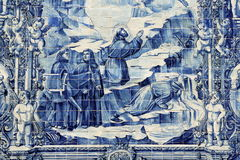Azulejos on Capela das Almas in Porto, Portugal. Azulejo depicting Francis of Assisi causing a spring of water to flow from a rock for a thirsty man accompanying Stock Image