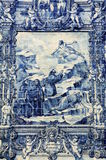Azulejos on Capela das Almas in Porto, Portugal. Azulejo depicting Francis of Assisi causing a spring of water to flow from a rock for a thirsty man accompanying Royalty Free Stock Images