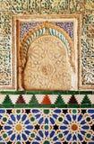 Azulejos and plasterwork, Alcazar Royal palace in Sevilla, Spain. Moorish Art, glazed tile skirting board and plaster work, palace royal Alcazar in Seville Royalty Free Stock Image