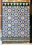 Azulejos, tiles glazed, Alcazar palace in Sevilla, Spain. Moorish Art, glazed tile skirting board (alicatados) in the palace royal Alcazar in Seville, Andalusia Royalty Free Stock Image