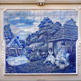 Painted Azulejos, Ceramic Tiles , Madeira Portugal. Azulejos: Traditional life on Madeira island. Funchal, street art. Azulejos, a painted ceramic tilework Royalty Free Stock Image
