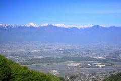 Azumino stad och Japan fjällängar Fotografering för Bildbyråer