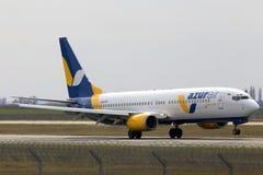 Azur Air Ukraine Boeing 737-800 aircraft landing on the runway. Borispol, Ukraine - March 25, 2017: Azur Air Ukraine Boeing 737-800 aircraft landing on the Stock Photo