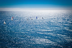 Azur blue sea with sailboats in sunset. Royalty Free Stock Image