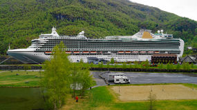 Azura docked in one of the Norwegian Fjords. Flam Norway 6 May 2014 P & O ship Azura docked to let passengers on day trip in Norway Fjords Royalty Free Stock Photos
