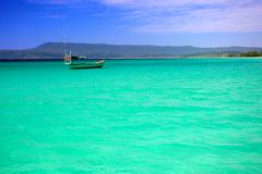 Azure bay, lagoon island of Koh Rong, Cambodia. Fishing boat at azure lagoon island of Koh Rong Stock Photography
