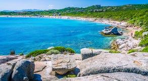 Azure beach full tourist at Porto Pollo on beautiful Sardinia island Sardinia, Italy Stock Photo