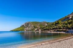 Azure blue Mediterranean beach surrounded by green trees. Beautiful azure blue Mediterranean beach surrounded by green trees in Croatia Stock Photography